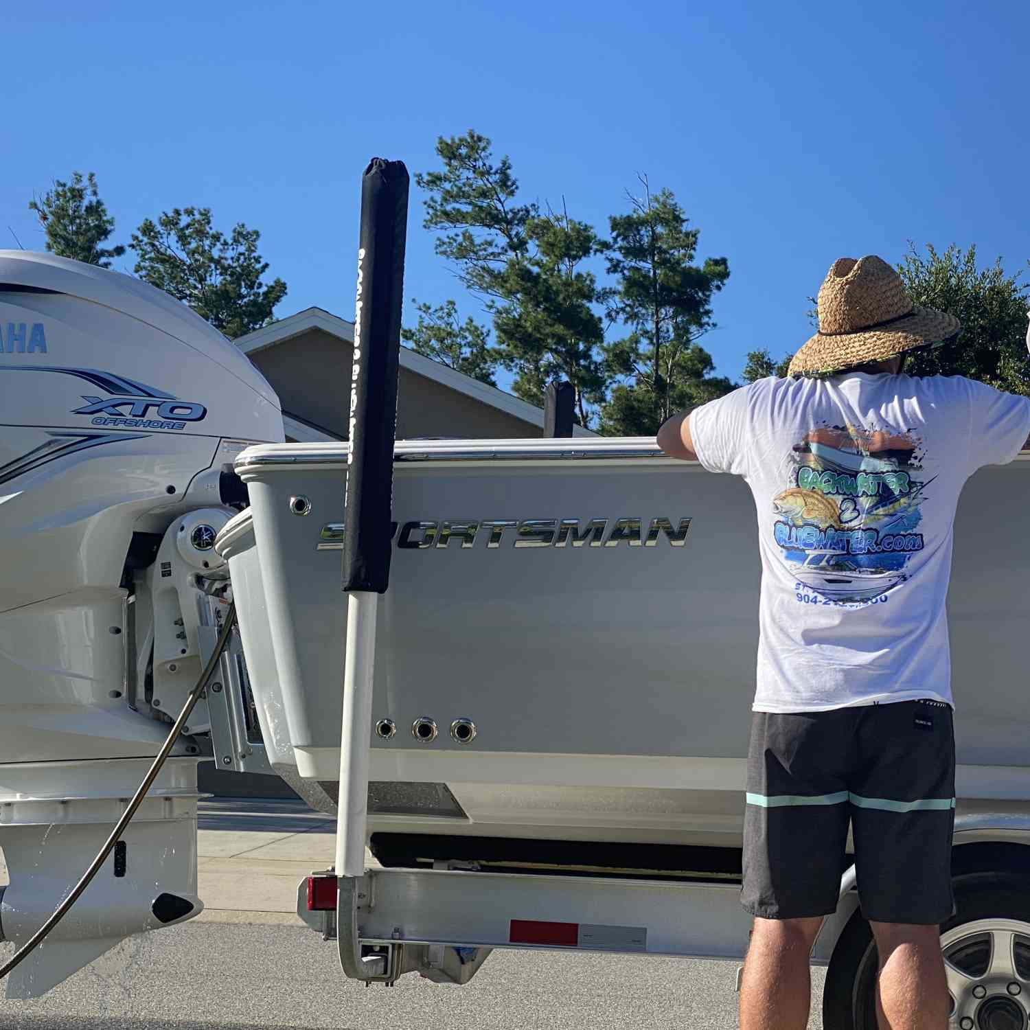 Just a man admiring his new boat.
