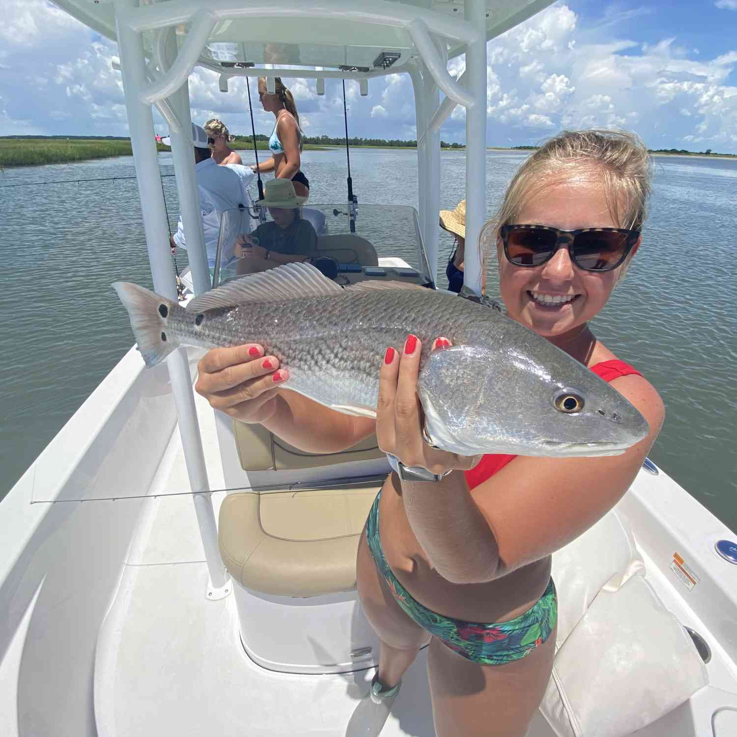 Title: Red fish - On board their Sportsman Masters 247 Bay Boat - Location: Folly beach, South Carolina. Participating in the Photo Contest #SportsmanAugust2020