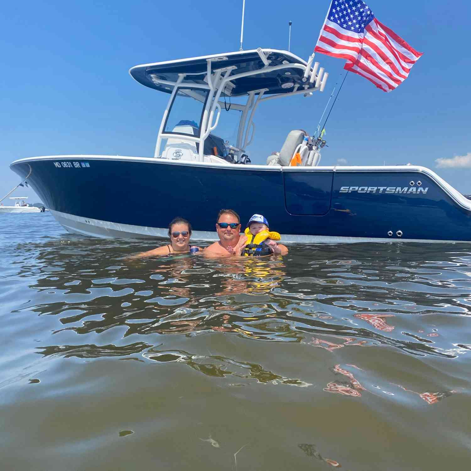Title: Family day. - On board their Sportsman Open 252 Center Console - Location: Kent island md. Participating in the Photo Contest #SportsmanAugust2020