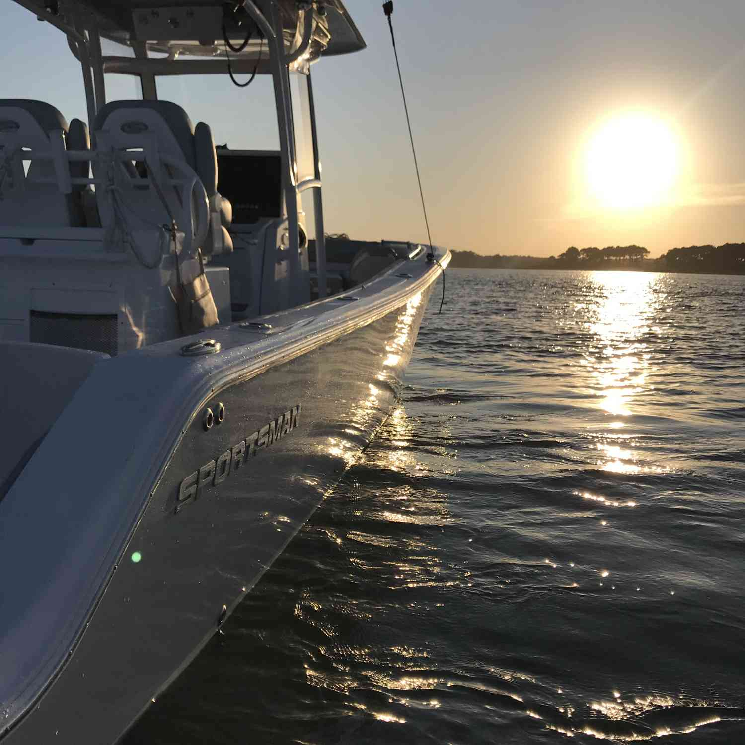 Title: A Sportsman Kind of Sunset - On board their Sportsman Open 282 Center Console - Location: Assateague Island, Maryland. Participating in the Photo Contest #SportsmanDecember2020