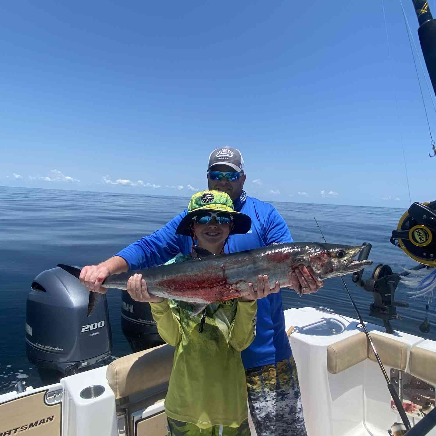 Title: His First King - On board their Sportsman Open 282TE Center Console - Location: Grays Reef off the Georgia coast. Participating in the Photo Contest #SportsmanJuly2020