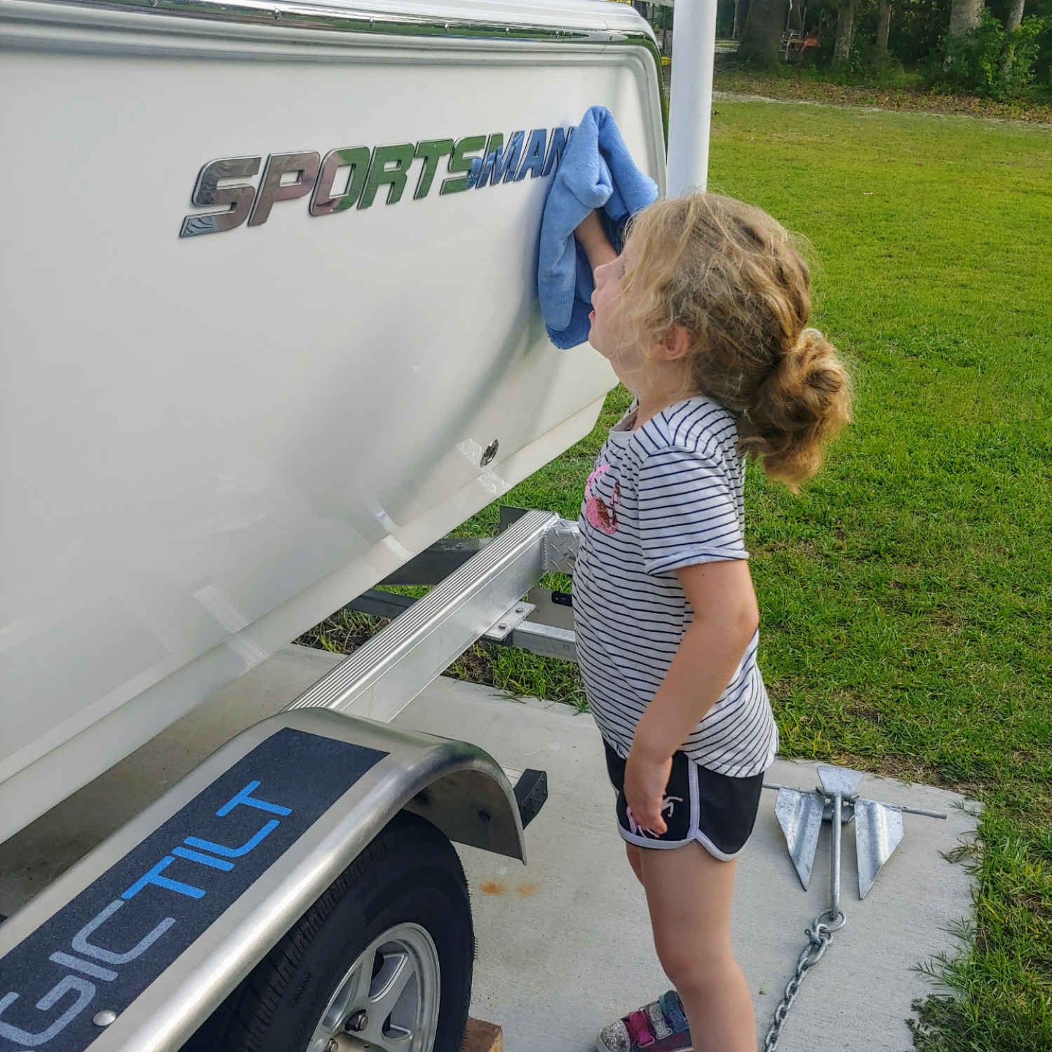 Title: Lil bit is shining her up! - On board their Sportsman Open 212 Center Console - Location: Richmond Hill, GA. Participating in the Photo Contest #SportsmanJuly2020