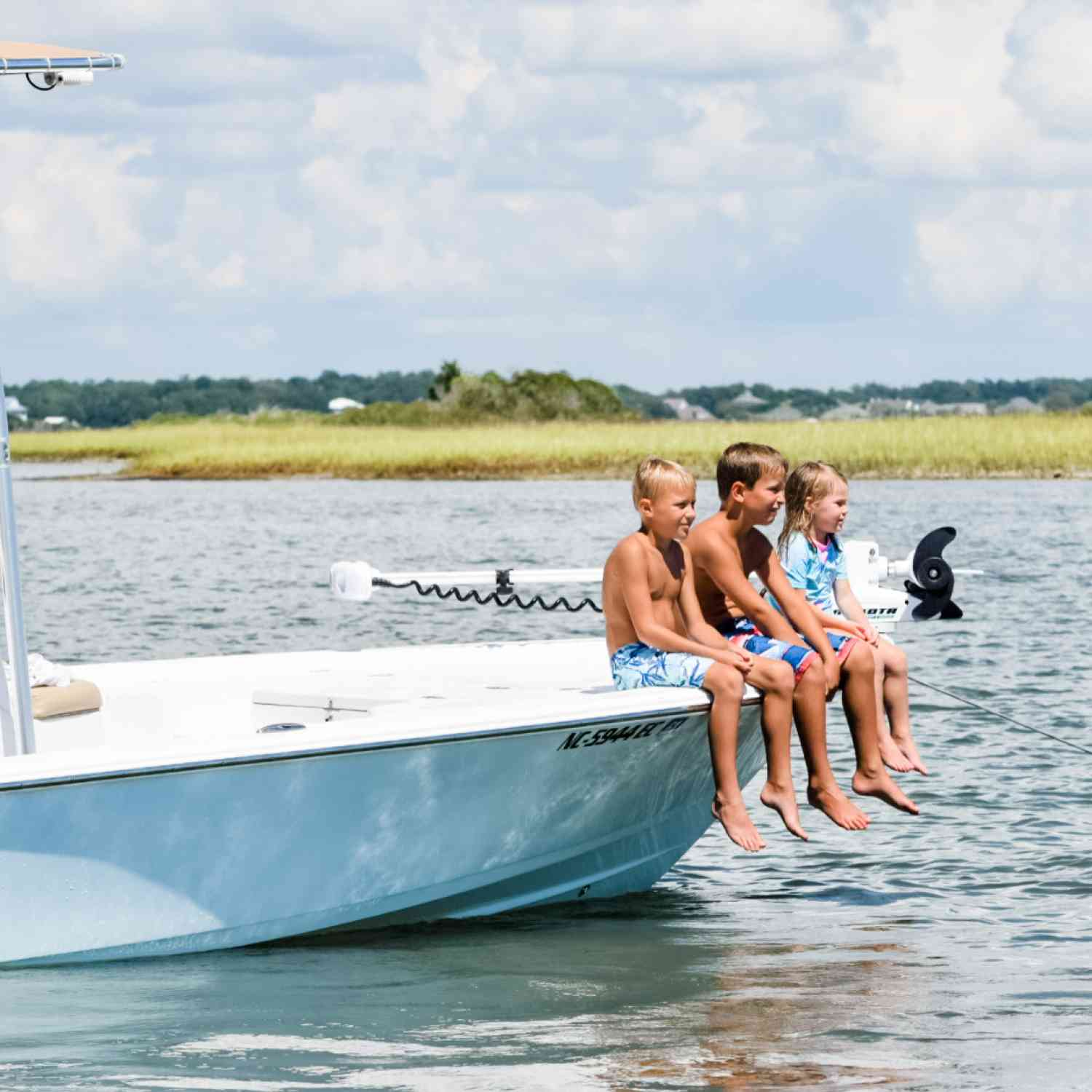 Title: Family Tides - On board their Sportsman Tournament 214 Bay Boat - Location: Swansboro, NC. Participating in the Photo Contest #SportsmanJuly2020