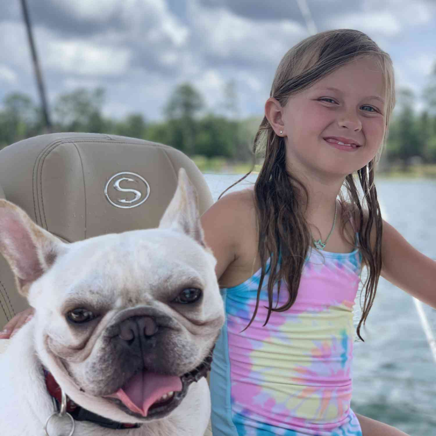 Title: Family - On board their Sportsman Masters 247 Bay Boat - Location: Camp blanding. Participating in the Photo Contest #SportsmanJuly2020