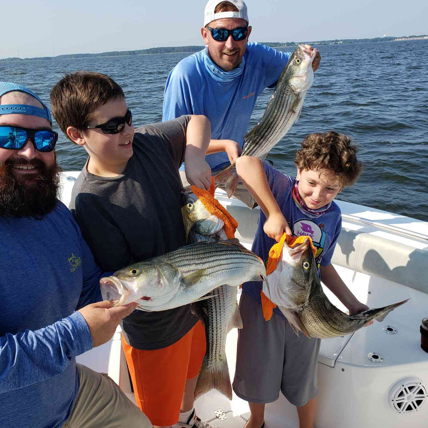 Title: Rockfishing - On board their Sportsman Open 252 Center Console - Location: Kent island md. Participating in the Photo Contest #SportsmanJuly2020