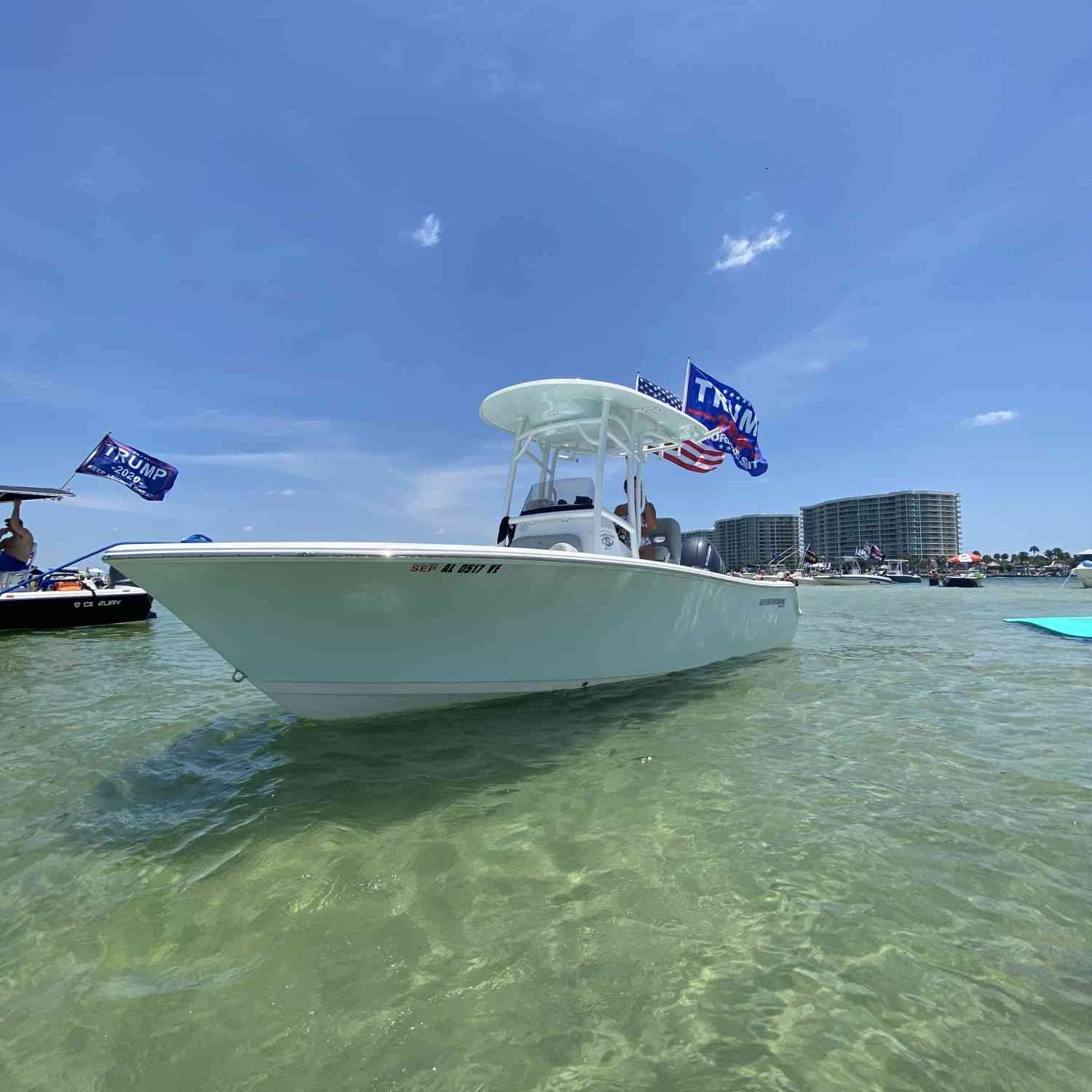 Title: Beach day - On board their Sportsman Heritage 211 Center Console - Location: Alabama. Participating in the Photo Contest #SportsmanJuly2020