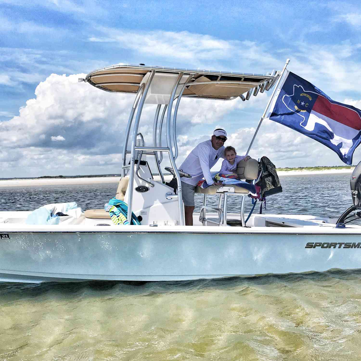 Title: NC Pig Flag Flying on Island Time - On board their Sportsman Tournament 214 Bay Boat - Location: Swansboro, NC. Participating in the Photo Contest #SportsmanJuly2020