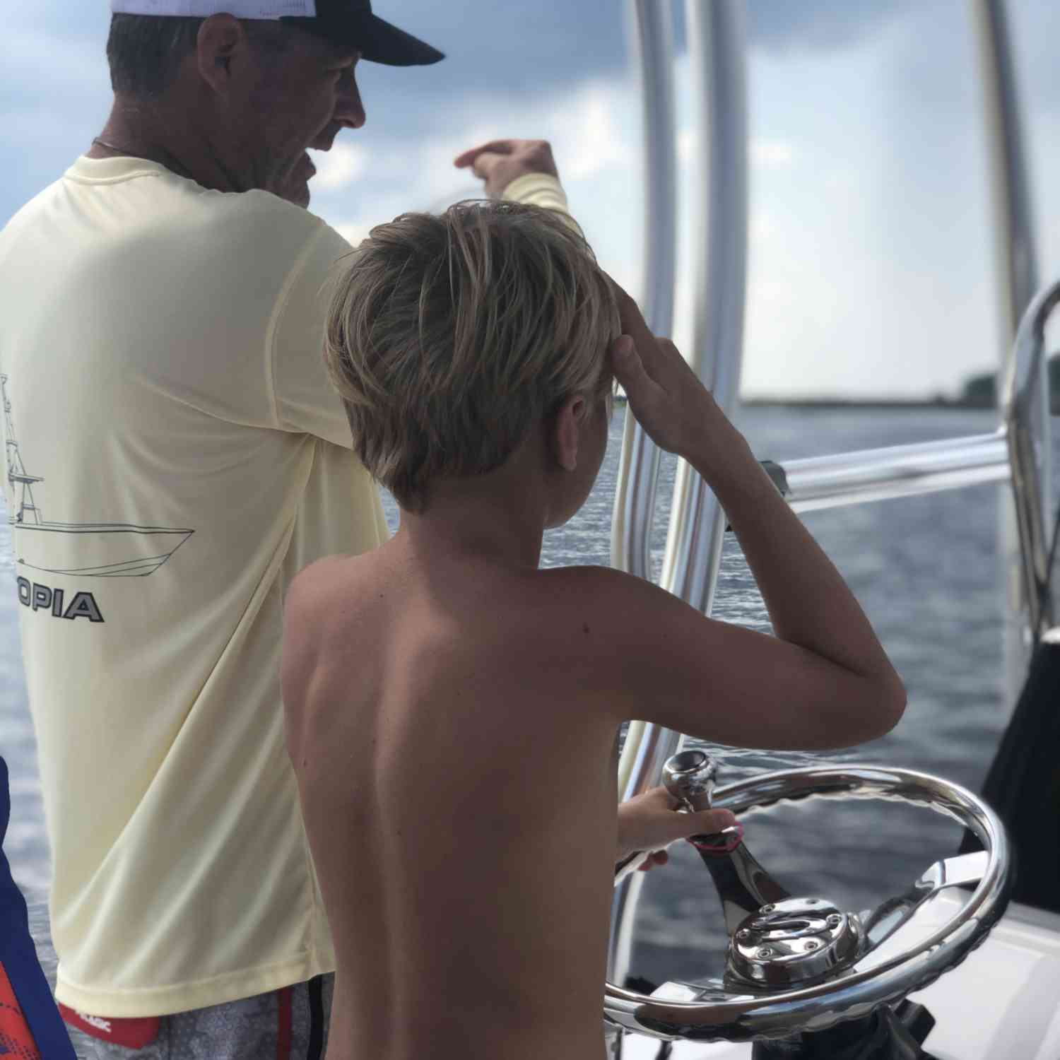 Title: Captain in Training - On board their Sportsman Tournament 214 Bay Boat - Location: Swansboro, NC. Participating in the Photo Contest #SportsmanJuly2020