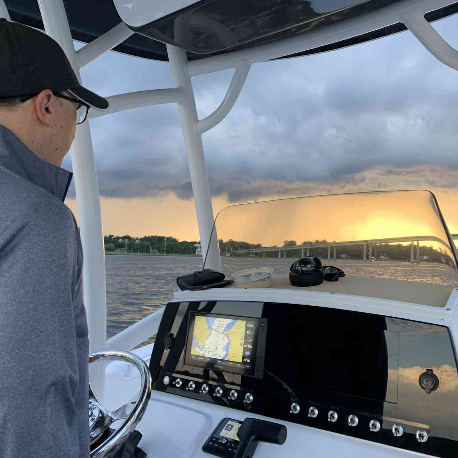 Title: Racing the Storm - On board their Sportsman Heritage 231 Center Console - Location: Severn River, Annapolis. Participating in the Photo Contest #SportsmanJuly2020