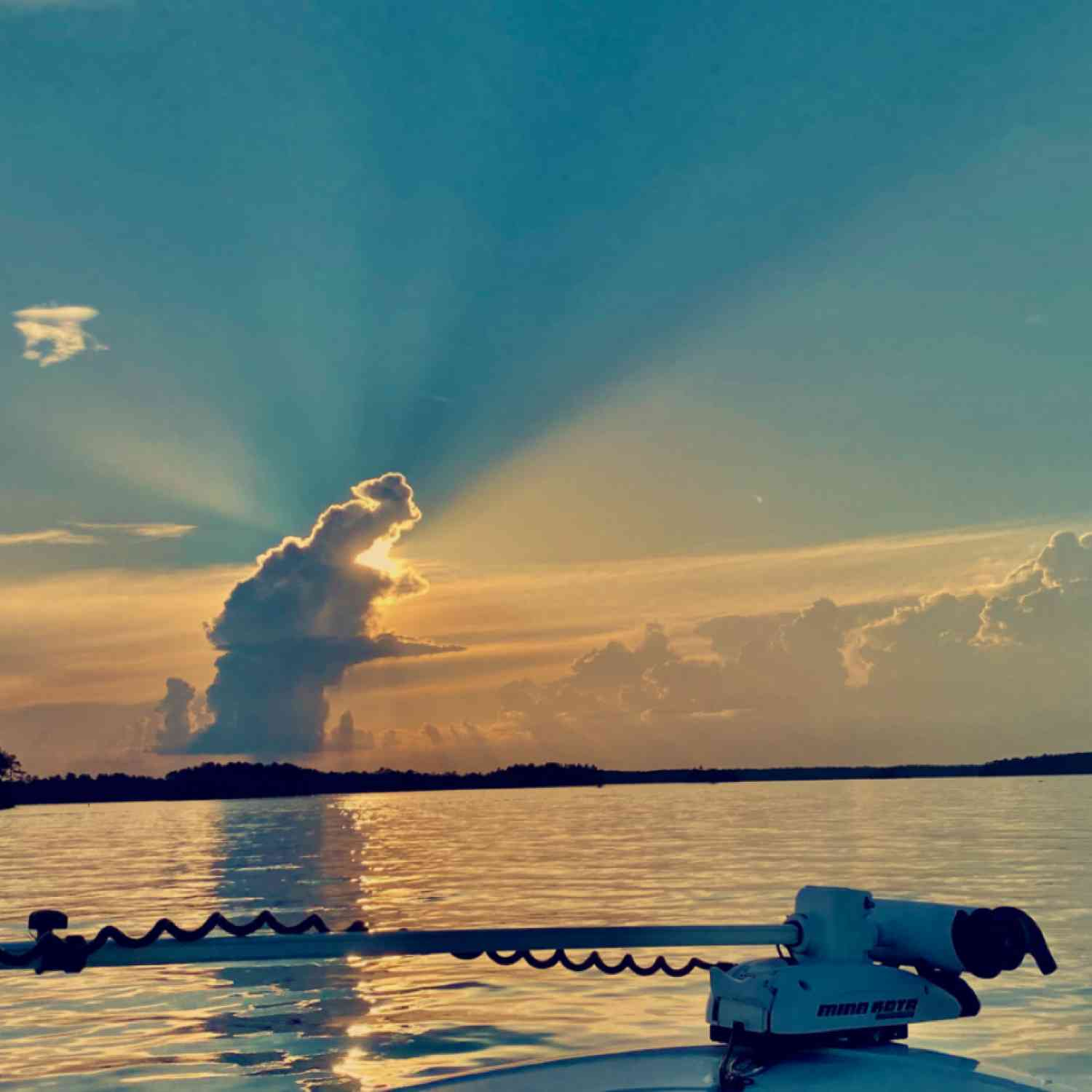 Title: Running from the storm - On board their Sportsman Heritage 231 Center Console - Location: Plum Branch, South Carolina. Participating in the Photo Contest #SportsmanJune2020