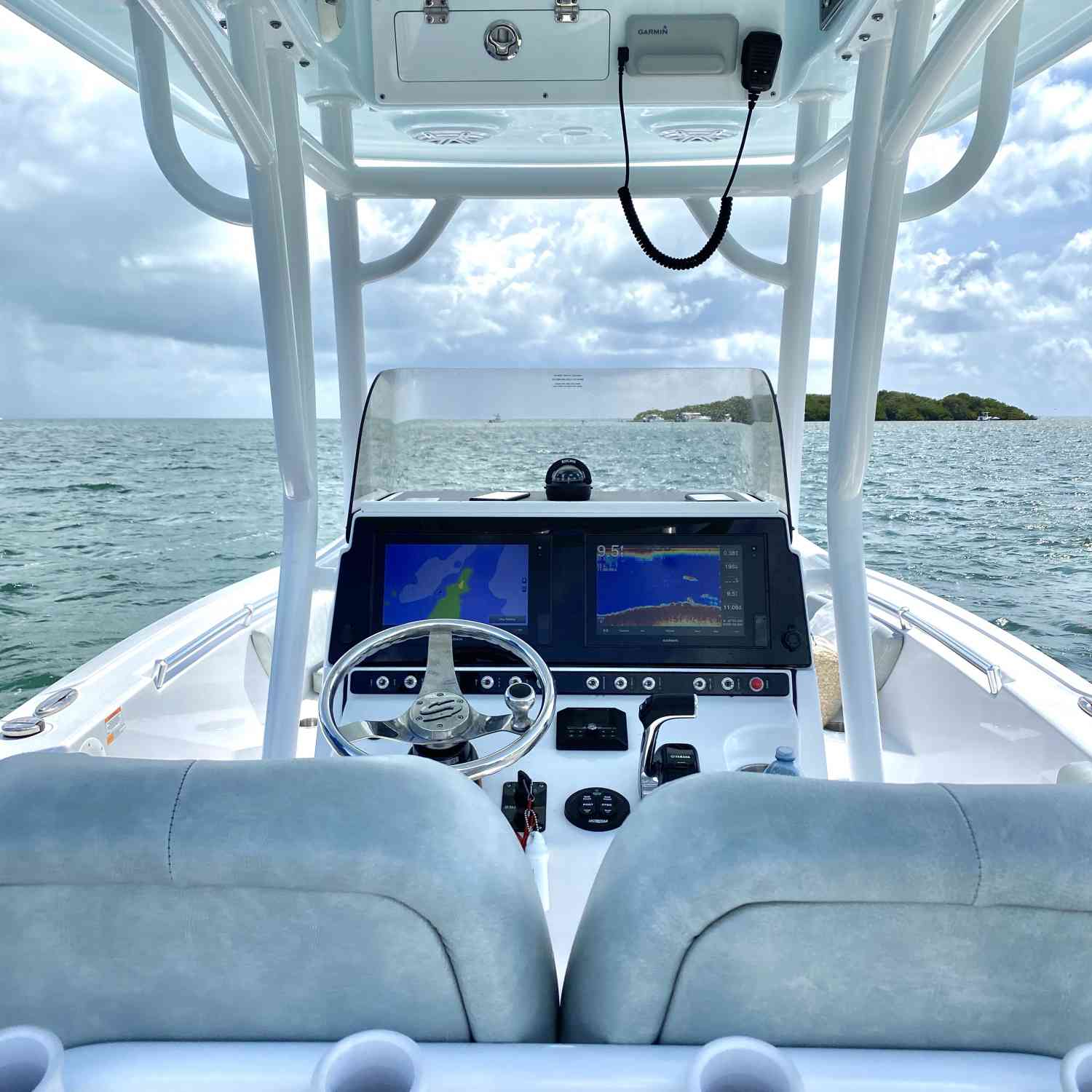 Title: The calm before the storm - On board their Sportsman Heritage 241 Center Console - Location: Miami, FL. Participating in the Photo Contest #SportsmanJune2020