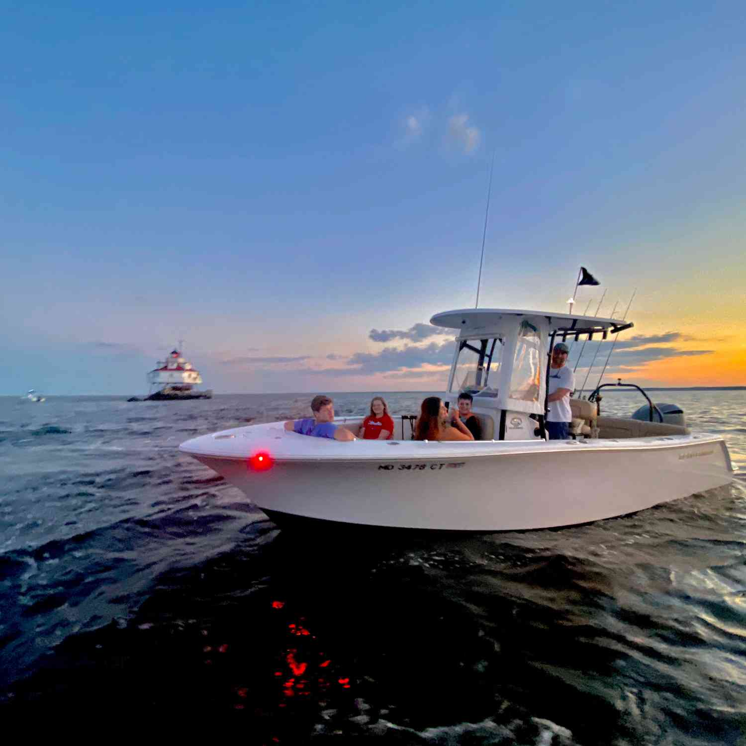 Title: Sunset at Thomas Point - On board their Sportsman Heritage 231 Center Console - Location: Thomas Point Shoal Lighthouse Annapolis, Maryland. Participating in the Photo Contest #SportsmanJune2020