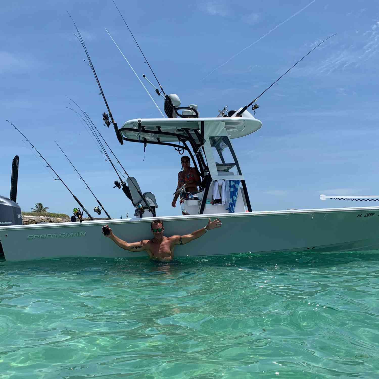 Title: Living the dream - On board their Sportsman Heritage 241 Center Console - Location: Boca Grande. Participating in the Photo Contest #SportsmanJune2020
