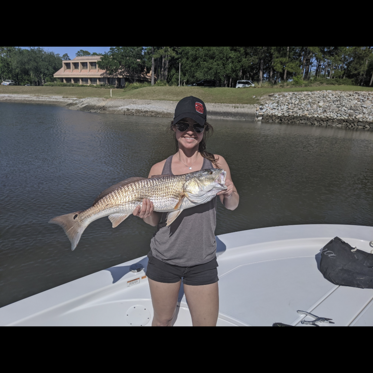 Title: Catchin Reds - On board their Sportsman Island Bay 20 Bay Boat - Location: Bluffton, south Carolina. Participating in the Photo Contest #SportsmanMay2020