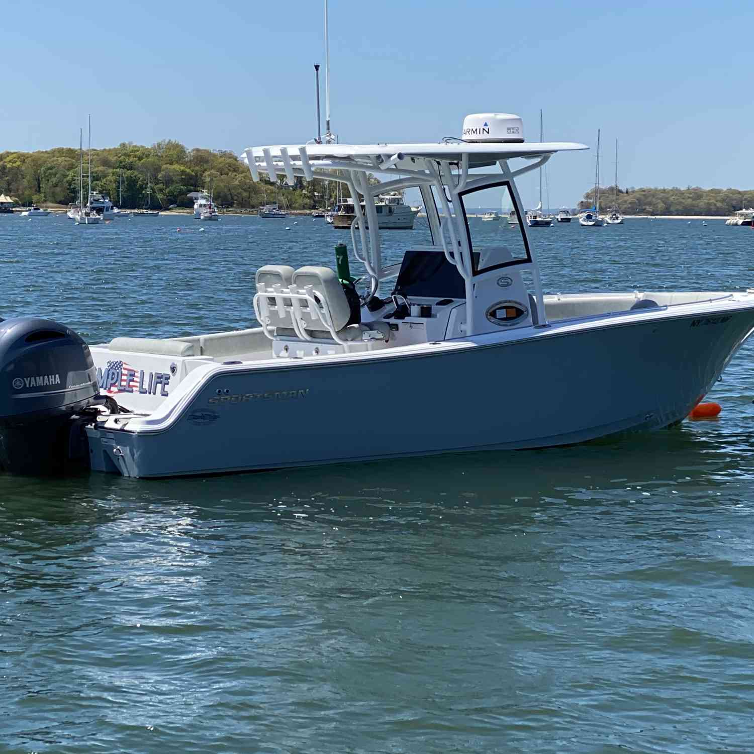 Title: Simple Life - On board their Sportsman Open 252 Center Console - Location: Northport, NY. Participating in the Photo Contest #SportsmanMay2020