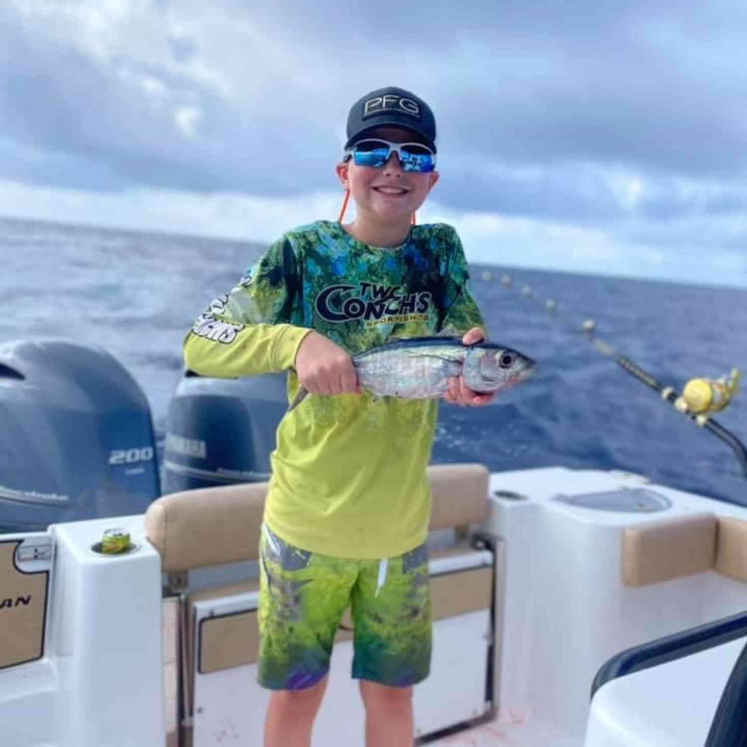 Title: Kason's first Tuna - On board their Sportsman Open 282TE Center Console - Location: West Humps out of Marathon, FL. Participating in the Photo Contest #SportsmanNovember2020