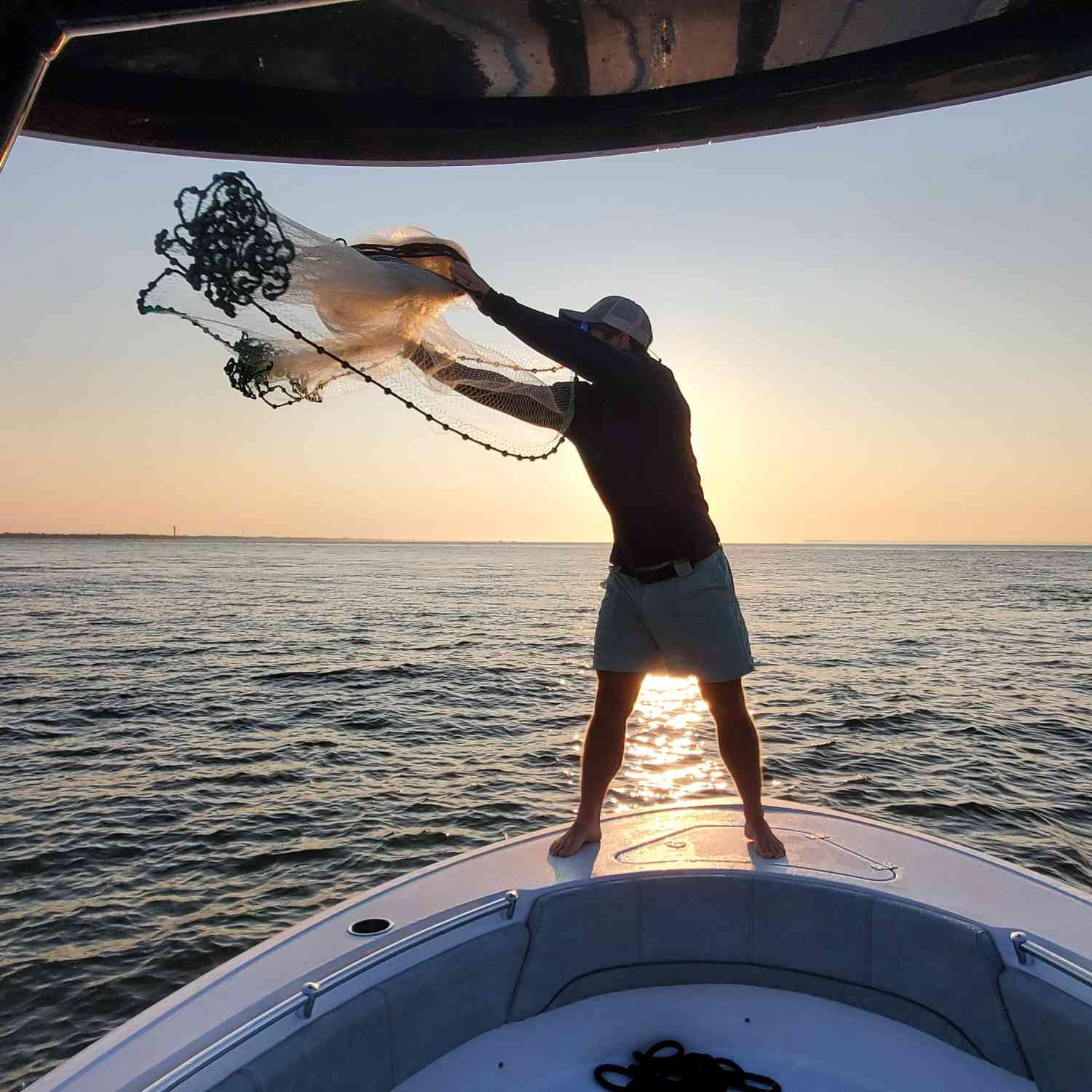 Title: Bait casting at sunrise - On board their Sportsman Heritage 231 Center Console - Location: Charleston Harbor. Participating in the Photo Contest #SportsmanOctober2020