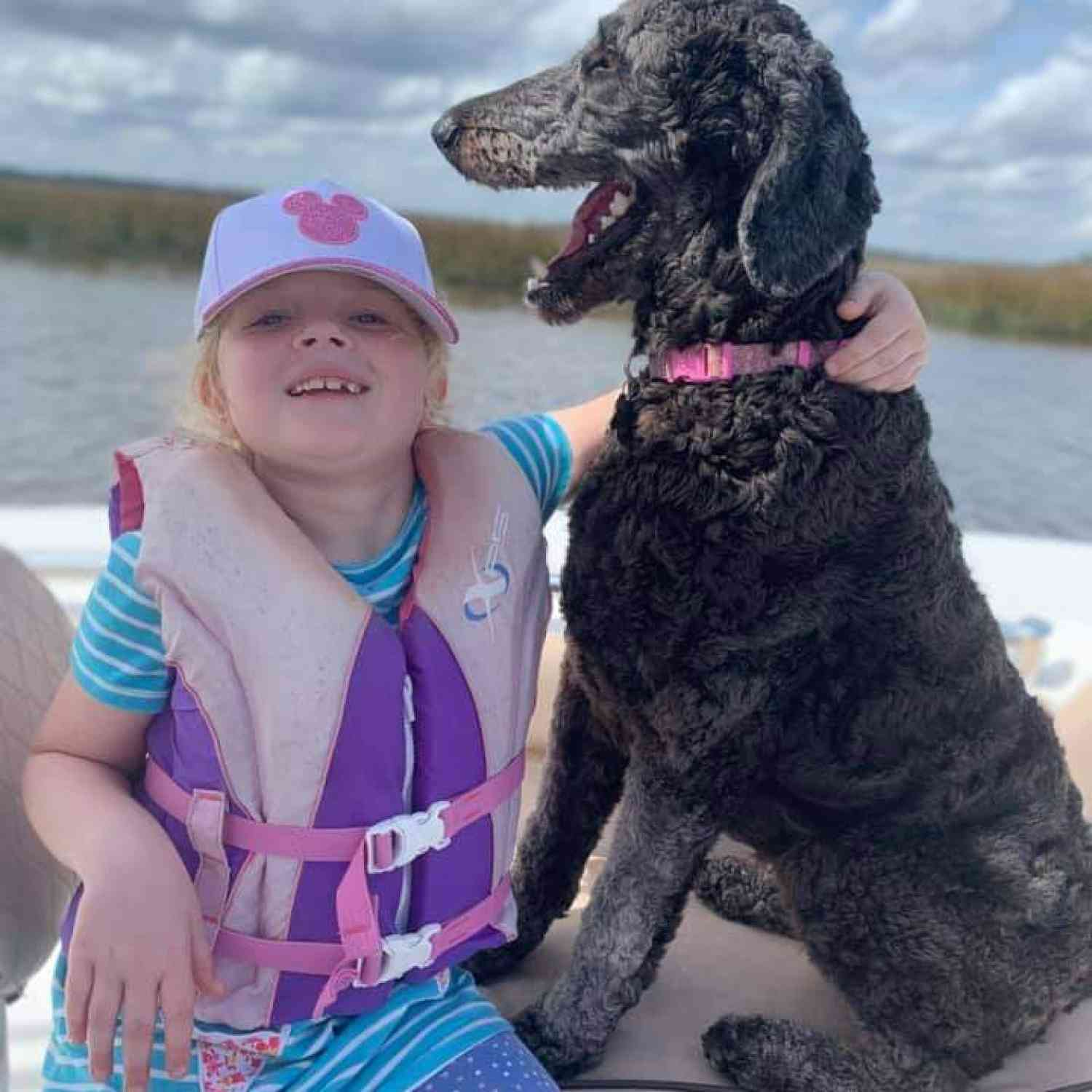 Title: A girl's best friend! - On board their Sportsman Open 212 Center Console - Location: Richmond Hill, GA. Participating in the Photo Contest #SportsmanApril2021