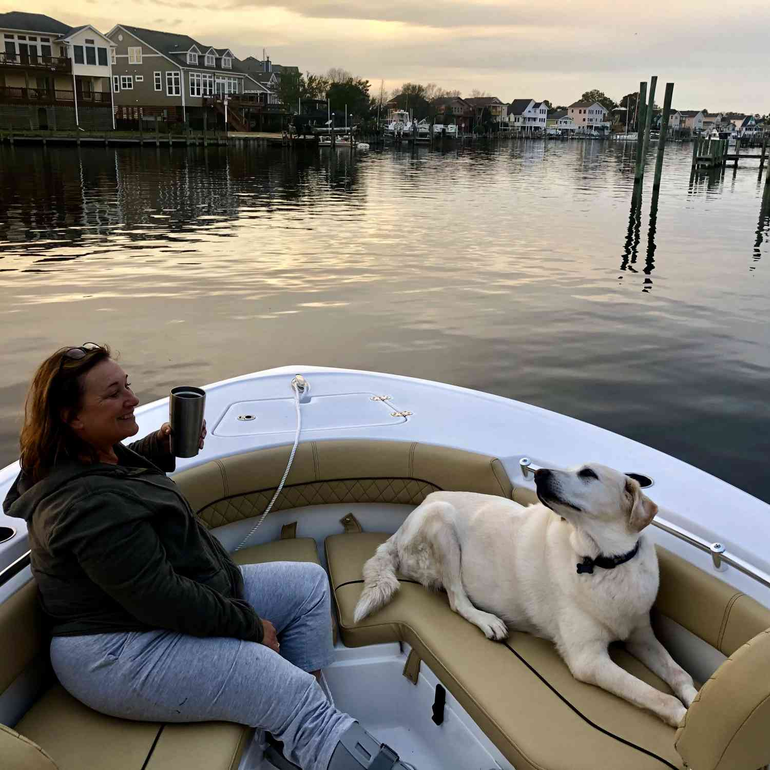 Susan and Zinny enjoying the calm waters from our very comfortable Sportsman Heritage 211.