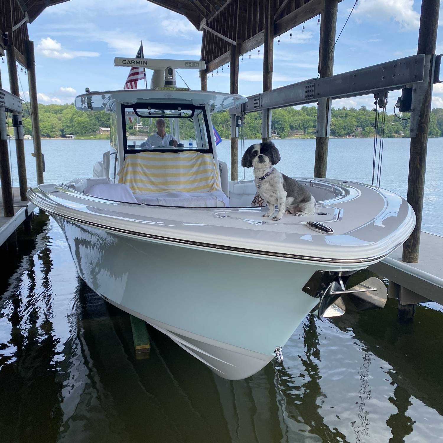 Title: Harley(shitzu) loves boat rides on the 352 - On board their Sportsman Open 352 Center Console - Location: Knoxville TN. Participating in the Photo Contest #SportsmanAugust2021