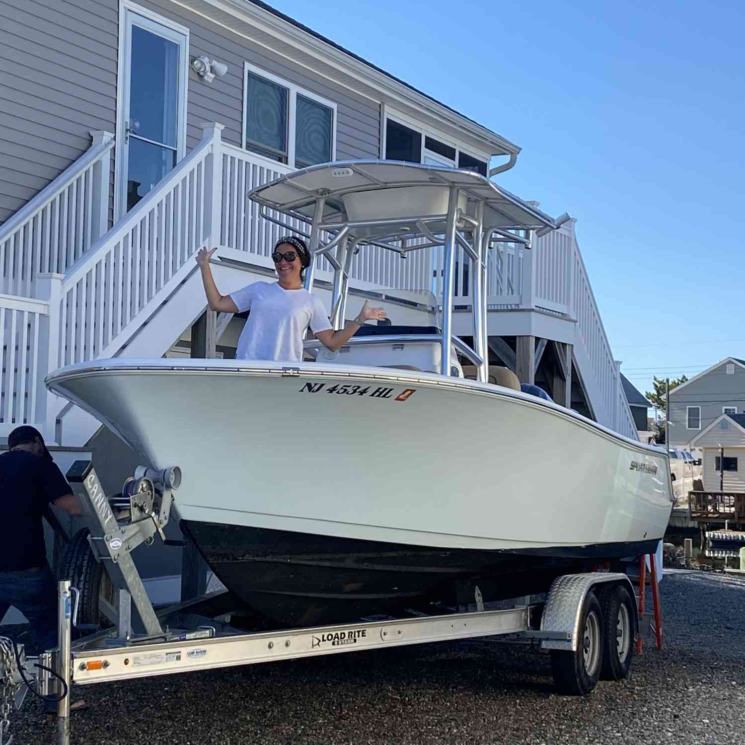 Title: Is it summer yet - On board their Sportsman Heritage 211 Center Console - Location: Mystic Island NJ. Participating in the Photo Contest #SportsmanFebruary2021