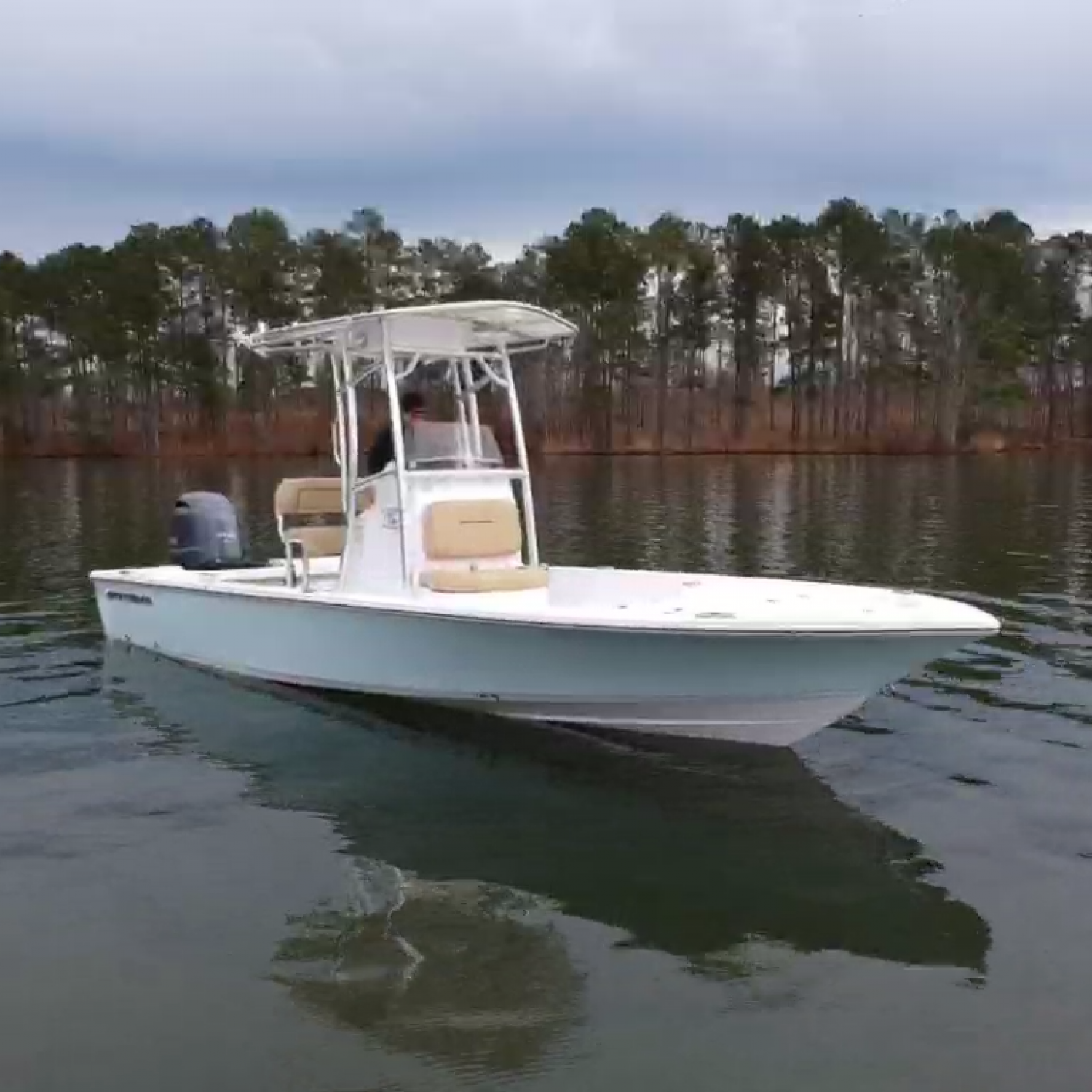 Title: Cold Lake Day - On board their Sportsman Tournament 234 SBX Bay Boat - Location: Lake Oconee. Participating in the Photo Contest #SportsmanFebruary2021
