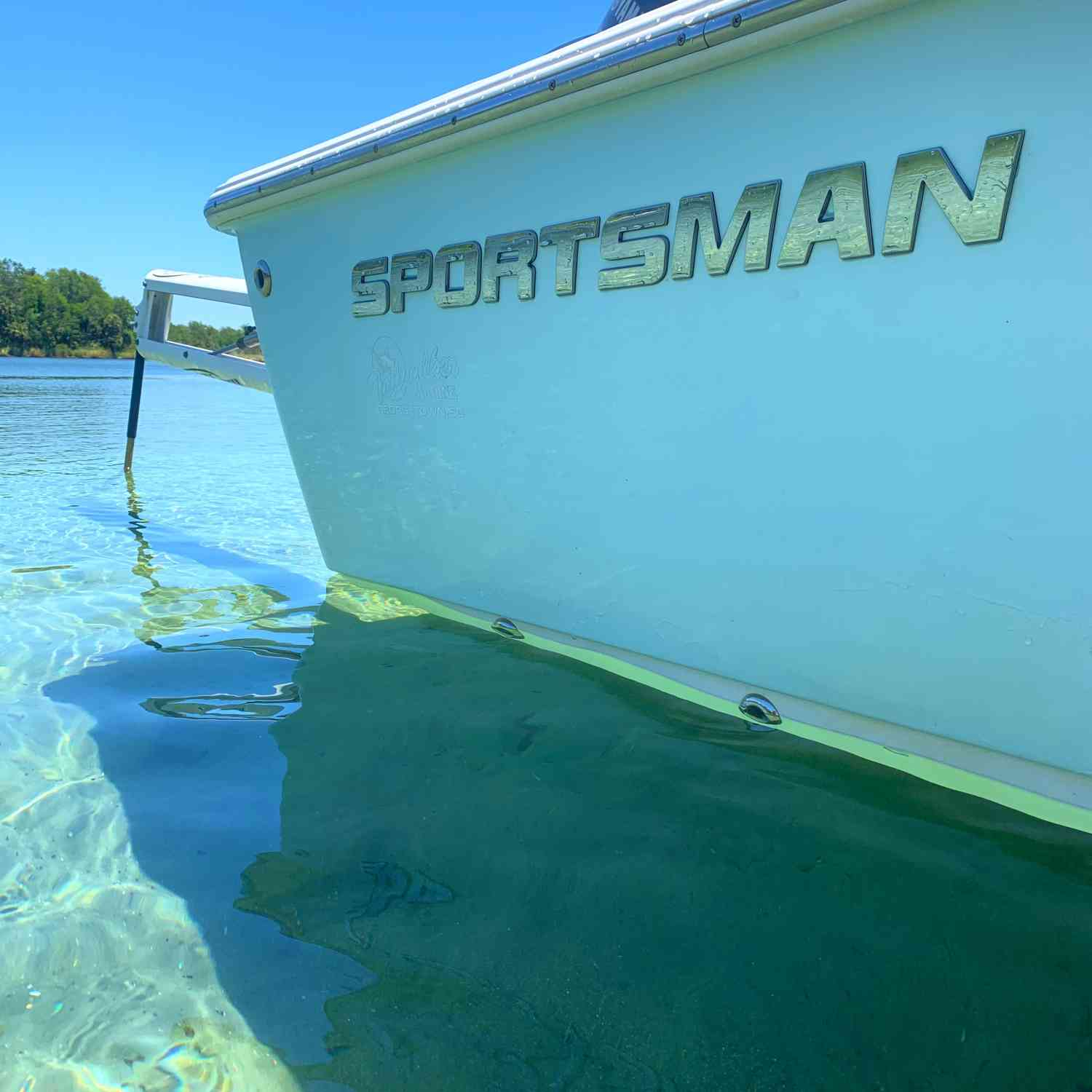 Title: Poles down at Silver Glenn Springs - On board their Sportsman Masters 207 Bay Boat - Location: Silver Glenn Springs. Participating in the Photo Contest #SportsmanFebruary2021