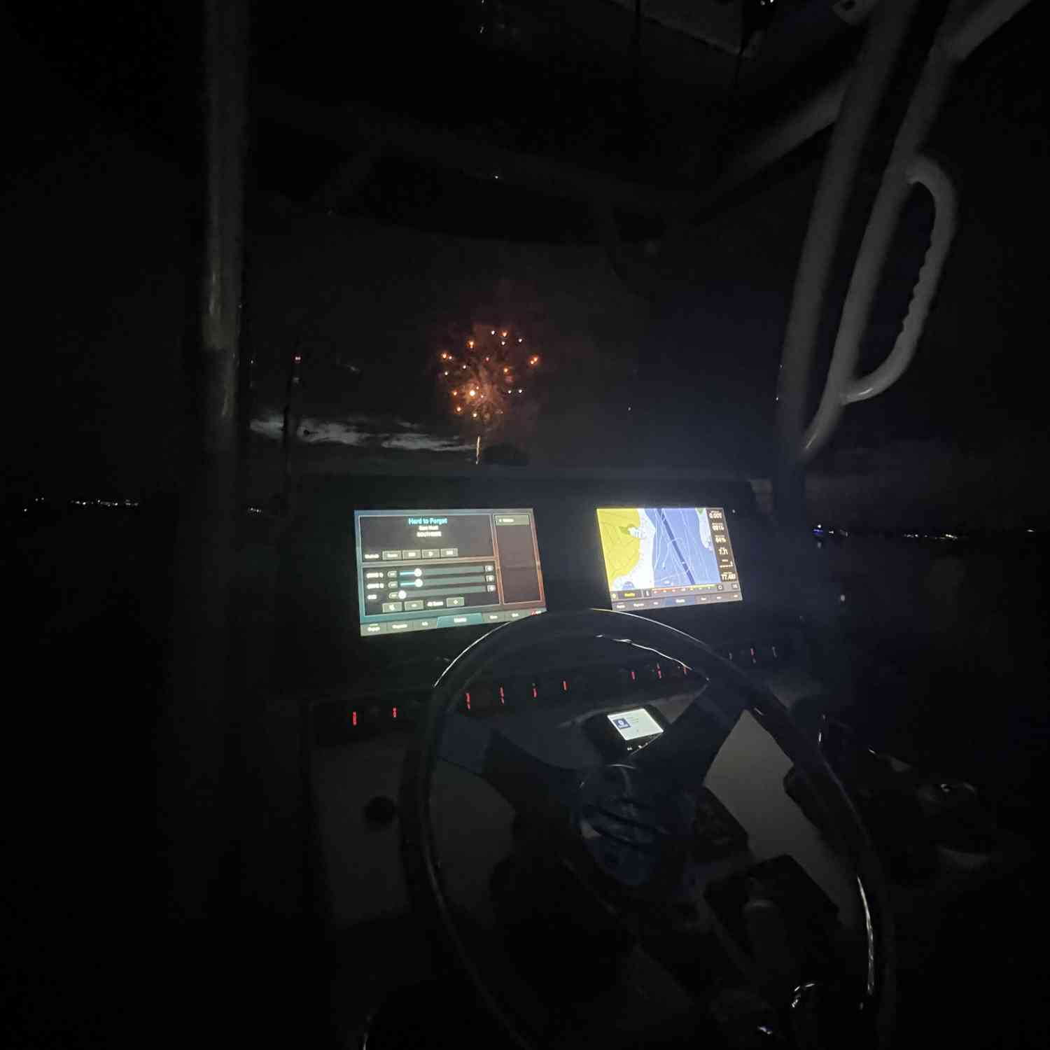 Title: Fireworks in the night - On board their Sportsman Heritage 241 Center Console - Location: Wilson point maryland. Participating in the Photo Contest #SportsmanJuly2021