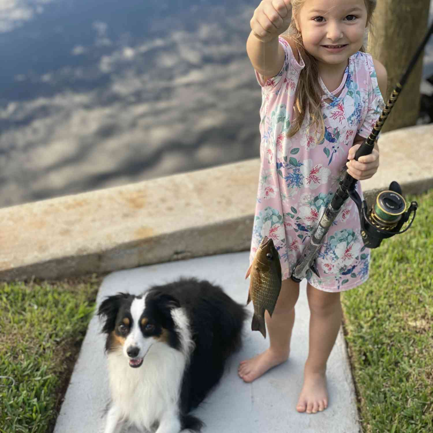 My daughter fishing at the house our boat will live. We can't wait for our first boat and are p...