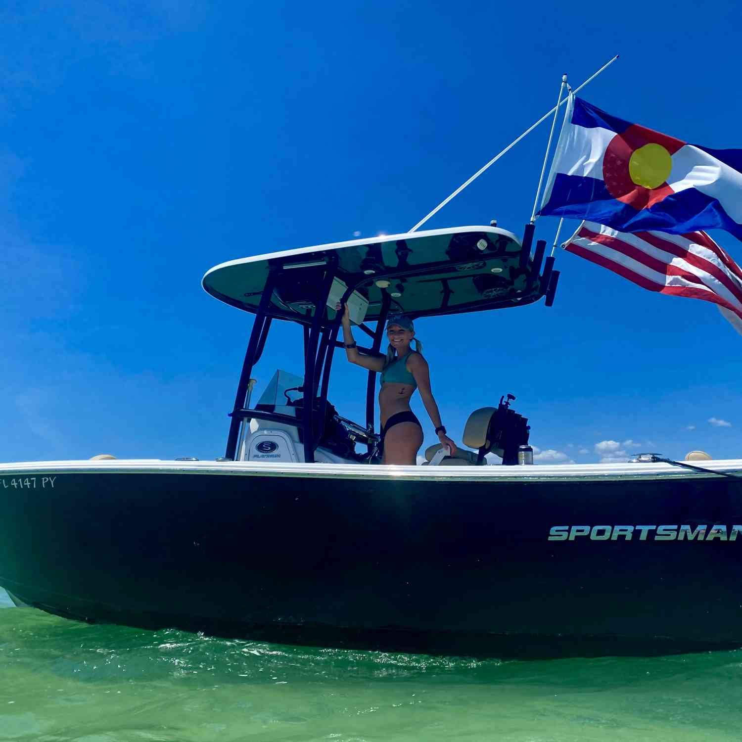 Title: Nice Looking Boat Too - On board their Sportsman Open 242 Center Console - Location: Passage Key. Participating in the Photo Contest #SportsmanJune2021