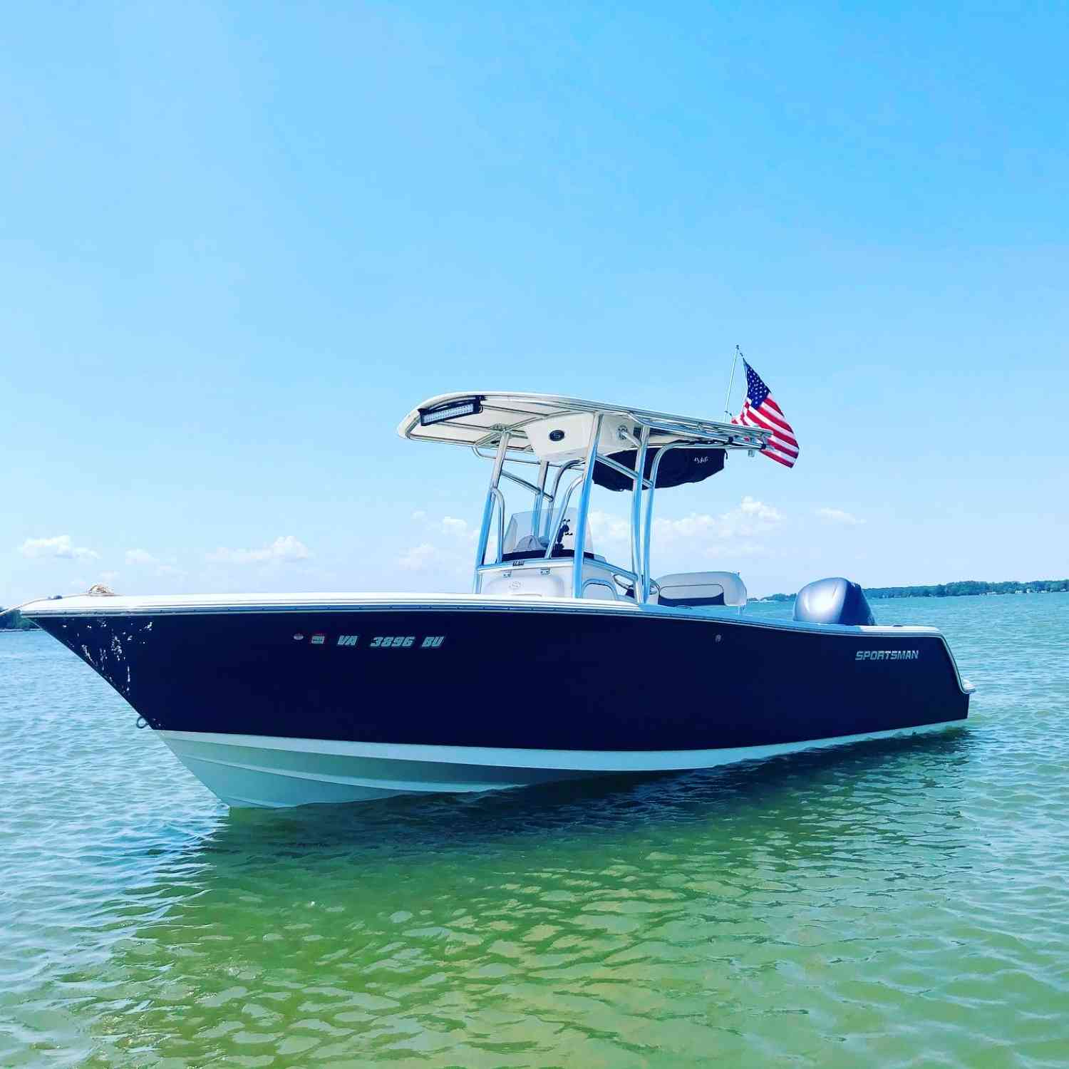 Title: Patriotism - On board their Sportsman Heritage 231 Center Console - Location: Gwynns Island VA. Participating in the Photo Contest #SportsmanJune2021