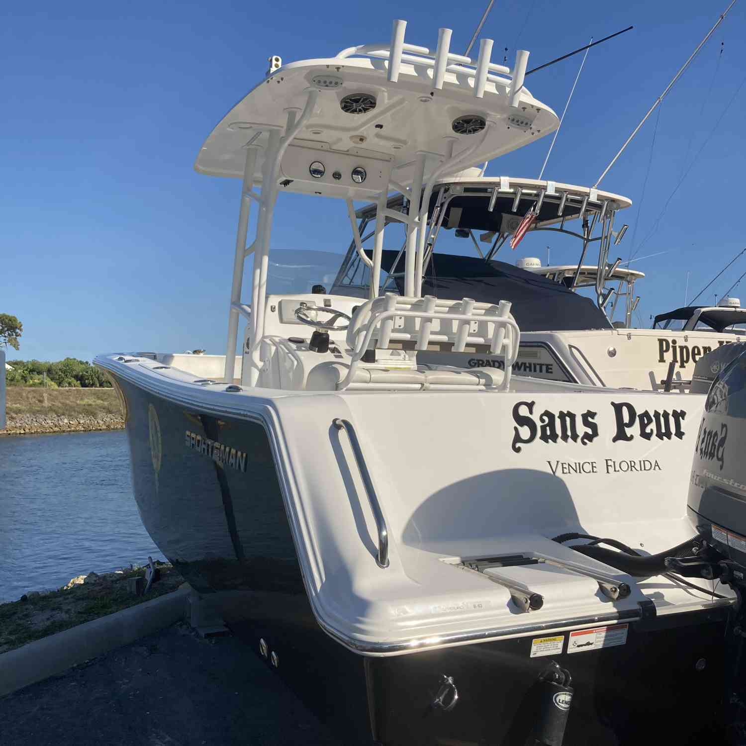 Title: Fresh buff with compound, wash and wax. - On board their Sportsman Open 232 Center Console - Location: Venice, Florida. Participating in the Photo Contest #SportsmanJune2021
