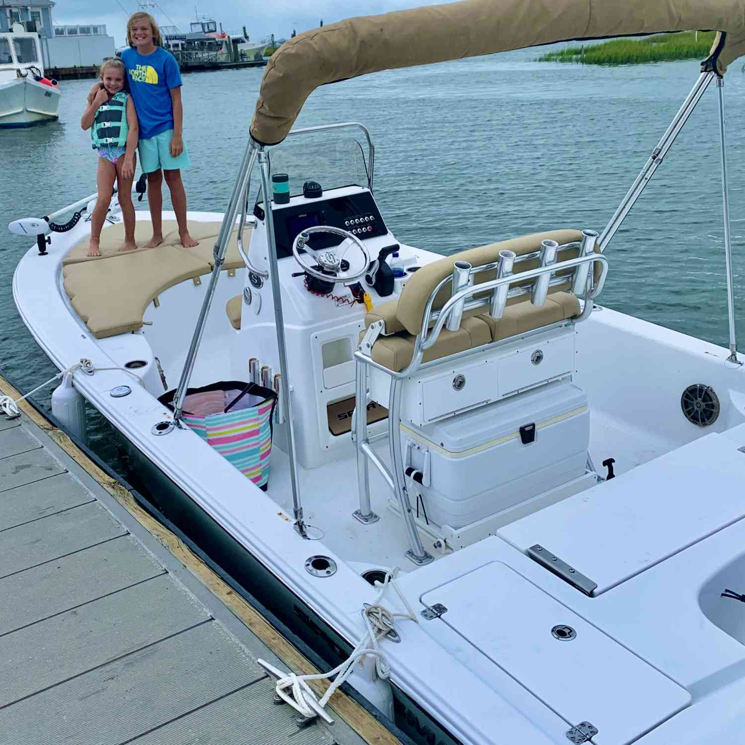 Title: Chasin' Em - On board their Sportsman Masters 207 Bay Boat - Location: Murrells Inlet, SC. Participating in the Photo Contest #SportsmanMay2021